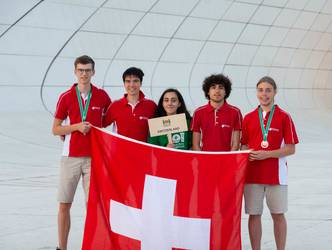 Swiss team at IOI 2019 after the medal ceremony